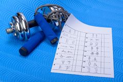 Sports fitness accessories and table Stock Photography