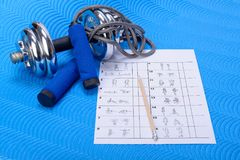 Sports fitness accessories and table Stock Photo
