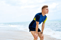 Sports, Fitness. Fit Man Taking Break After Running.  Athletics, Royalty Free Stock Photography