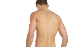 Sports and fitness topic: naked sporty man standing back isolated on a white background in the studio, human anatomy Royalty Free Stock Images