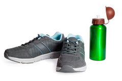 Sports footwear, thermos for water. Royalty Free Stock Images