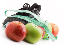 Sports and fruit diet, running shoes. With apples on a white background Stock Image