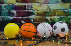 Sports game balls. Sports balls souvenirs against the background of a color wall Royalty Free Stock Photo