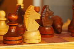 Chess pieces on the table. royalty free stock images