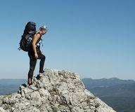 Sports girl. On the rock cliff Stock Photography