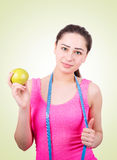 Sports girl with apple and tape Royalty Free Stock Images