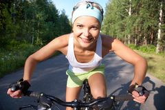 Sports girl with bike Royalty Free Stock Photography