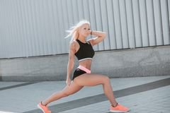 Sports girl blonde royalty free stock photography