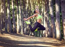 Sports girl brunette jumped in nature. Stock Photography