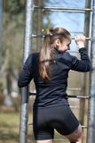 Sports girl on the crossbar. For any purpose royalty free stock photo