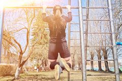 Sports girl on the crossbar. For any purpose royalty free stock photos