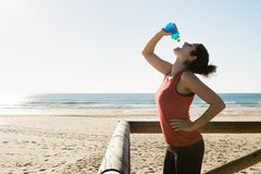 Sports girl drinking water Stock Images