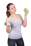 Sports girl with dumbbells and apple Royalty Free Stock Image