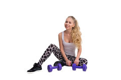 Sports girl with dumbbells. On white, isolated background royalty free stock image