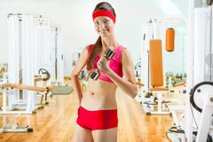 A sports girl with dumbell in gim Royalty Free Stock Image