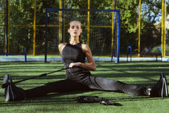 Sports girl with espander outdoor Royalty Free Stock Image