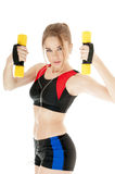 Sports girl  exercising with dumbbells. Stock Photos