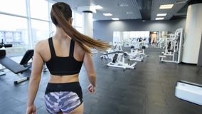 Sports girl goes to the gym.  stock footage