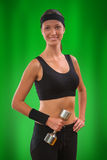 A sports girl on green background Stock Image