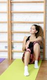 Sports girl has a rest after exercise Royalty Free Stock Images