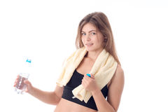 Sports girl holding a bottle of water and  towel on the shoulders  isolated  white background Royalty Free Stock Image
