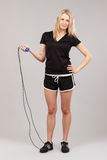 Sports girl holding a rope Stock Images