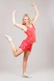 Sports girl joyfully jumps Stock Photo