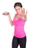Sports girl prohibits eating sweet Stock Photography