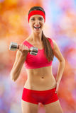 A sports girl in red wear Royalty Free Stock Images