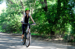 Sports girl riding a bicycle. Royalty Free Stock Photography