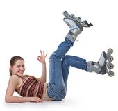 Sports girl with roller skates Royalty Free Stock Images