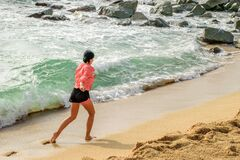 Free Sports Girl Running On The Beach. Sport Outdoor Activities, Enjoying Life Royalty Free Stock Image - 179779486