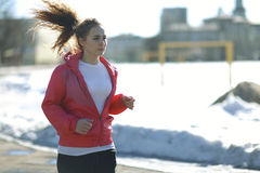 Sports girl running at stadium Royalty Free Stock Images
