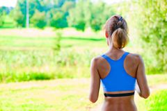 Sports girl runs in the morning in the park Royalty Free Stock Photography
