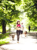 Sports girl runs in park effect films Royalty Free Stock Photo