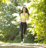 Sports girl runs in park effect films Royalty Free Stock Images