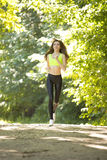 Sports girl runs in park effect films Stock Images