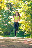Sports girl runs in park effect films Stock Photos