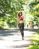 Sports girl runs in park effect films Royalty Free Stock Photography