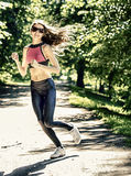 Sports girl runs in park effect films Stock Photo
