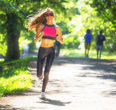 Sports girl runs in park effect films Royalty Free Stock Photos