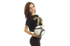 Sports girl smiling on camera with soccer ball in her hands Royalty Free Stock Images