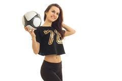 Sports girl with soccer ball in hands smilingbackground Royalty Free Stock Images