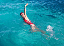 Sports girl swims in the sea Royalty Free Stock Images