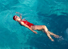 Sports girl swims in the sea Stock Photo