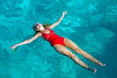 Sports girl swims in the sea Stock Photography