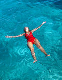 Sports girl swims in the sea Royalty Free Stock Photos