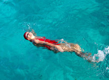 Sports girl swims in the sea Royalty Free Stock Image