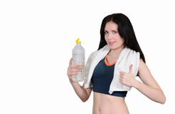 The sports girl with a towel and mineral water Royalty Free Stock Images