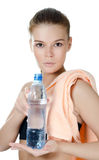 The sports girl with a towel and a water bottle Stock Photos